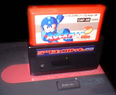 Rockman 2 works great!  And no fucked-up music like with the Game Genie!